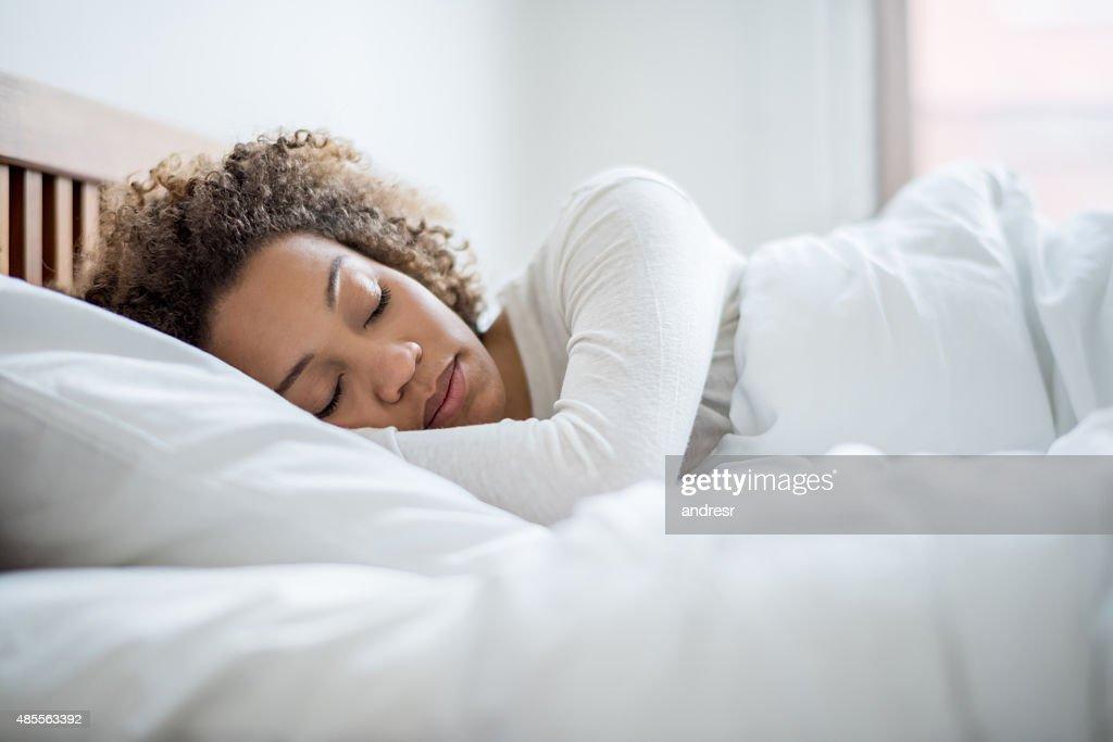 Black woman sleeping in bed : Stock Photo
