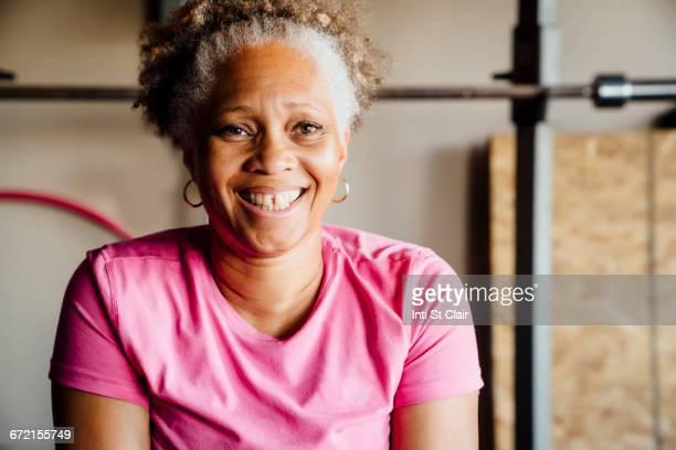 Black woman smiling in garage