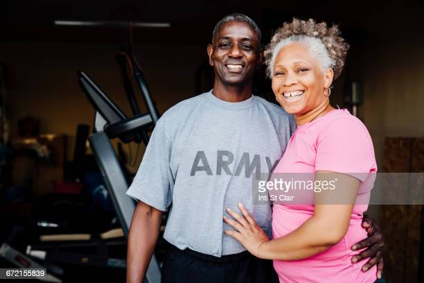 black woman smiling in garage - veteran stock pictures, royalty-free photos & images