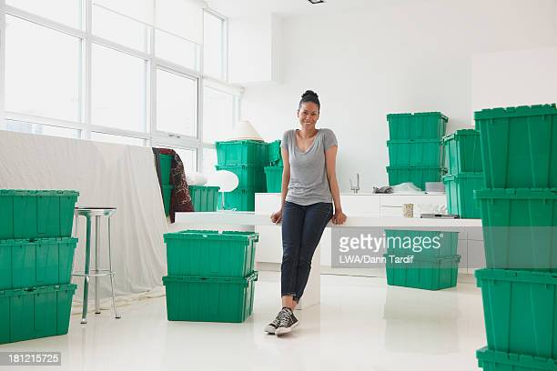 Black woman smiling in new house