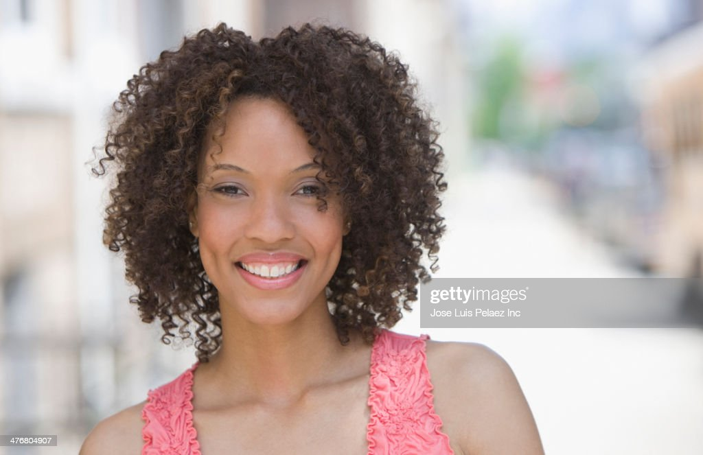 Black woman smiling outdoors : Stock Photo