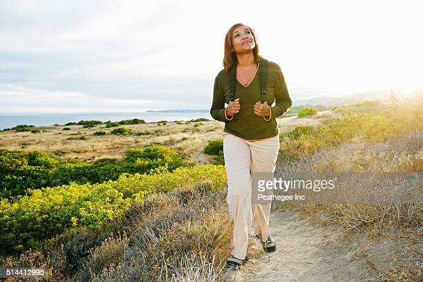 Black woman standing on rural hillside