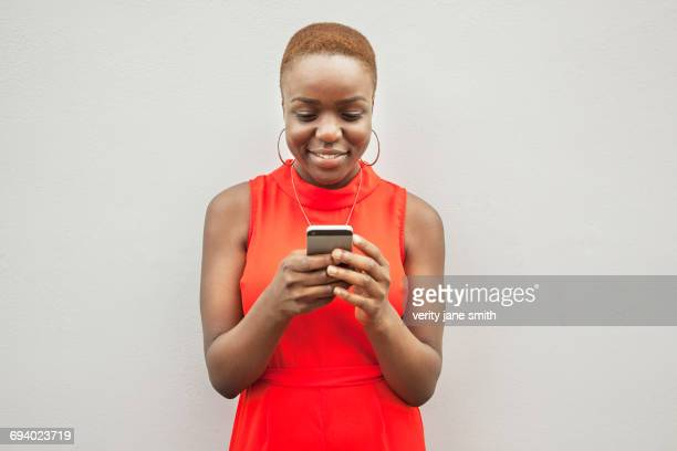 Black woman texting on cell phone