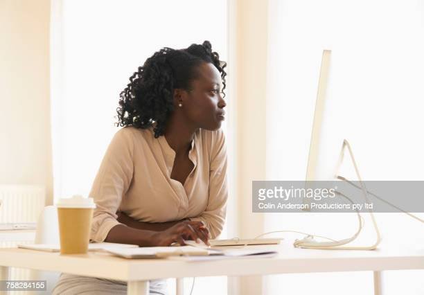 Black woman using computer in office