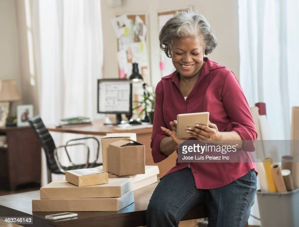 Black woman using digital tablet