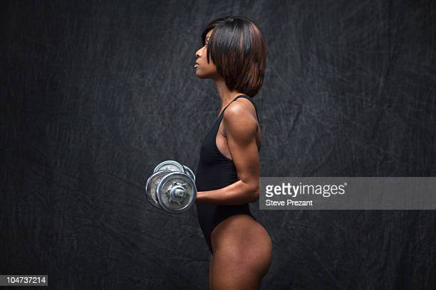 black woman using hand weights - black female bodybuilder stock photos and pictures
