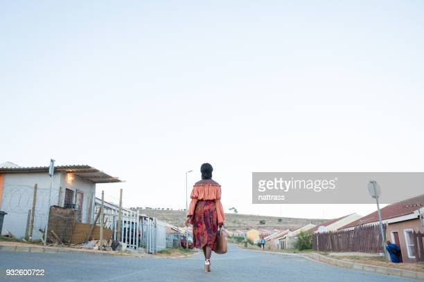 black woman walking to work - township stock pictures, royalty-free photos & images