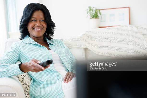 Black woman watching television