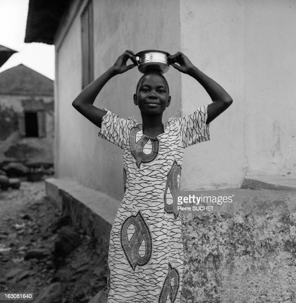CONTENT] Black woman wearing a wax dress and holding a small steel pan Tomegbé Togo 2013