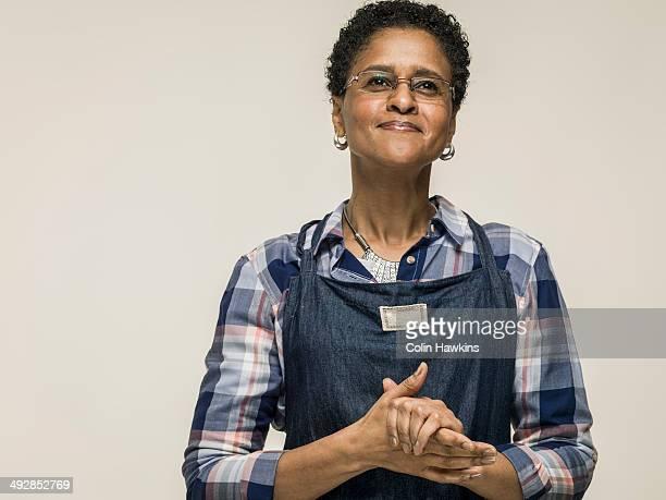 Black woman wearing craft apron