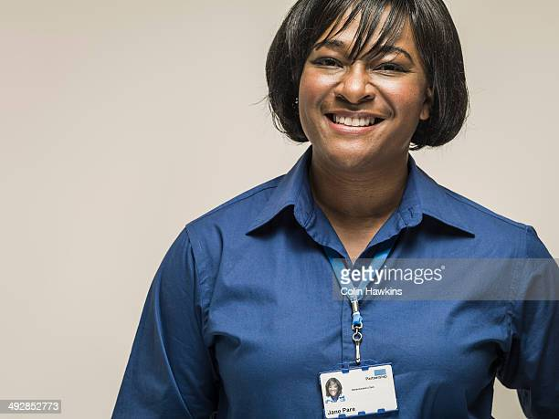 Black woman wearing work identity lanyard