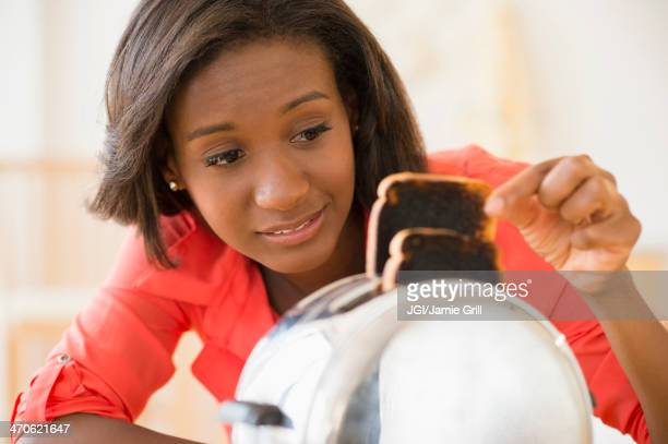 Black woman with burned toast