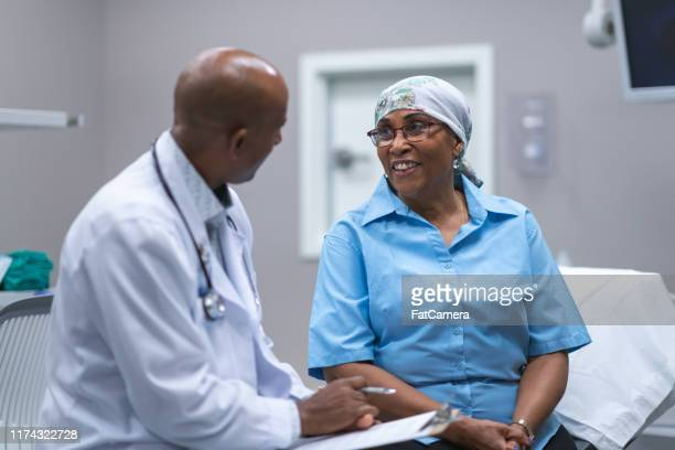 black woman with cancer in medical consultation - oncology stock pictures, royalty-free photos & images