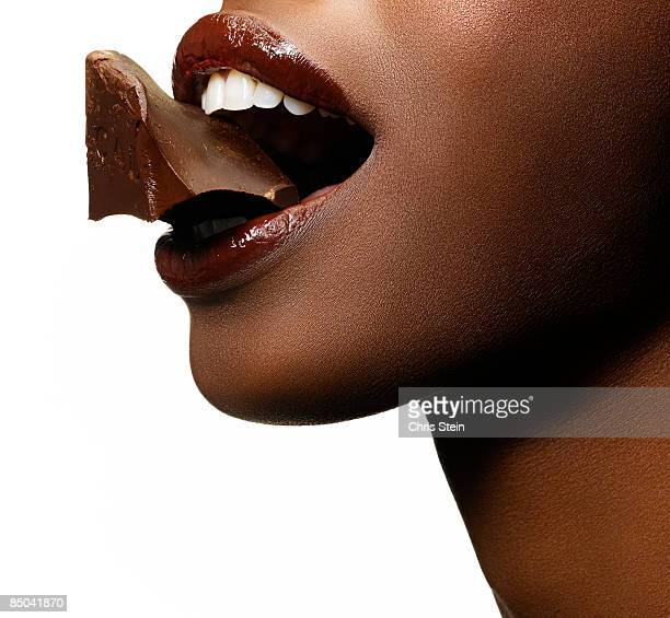 Black Woman with Chocolate in her mouth