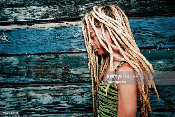 black woman with dreadlocks at wooden wall - dreadlocks stock pictures, royalty-free photos & images