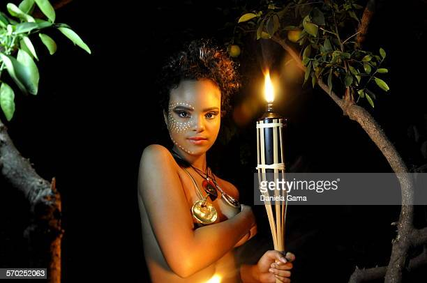 Black woman with paint and a burning torch