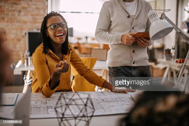 black woman with surprised emotion at office - creative director stock pictures, royalty-free photos & images