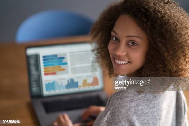 black woman working online at home - financial advisor stock pictures, royalty-free photos & images