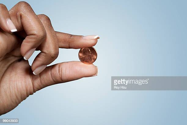 Black woman's hand holing penny