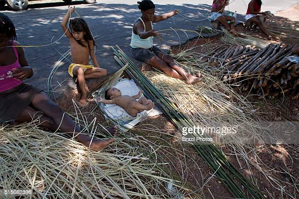 Black women make tapiti at Sao Raimundo Quilombo in Alcantara Maranhao State Northeastern Brazil tapiti is a a long tubeshaped basket of woven plant...