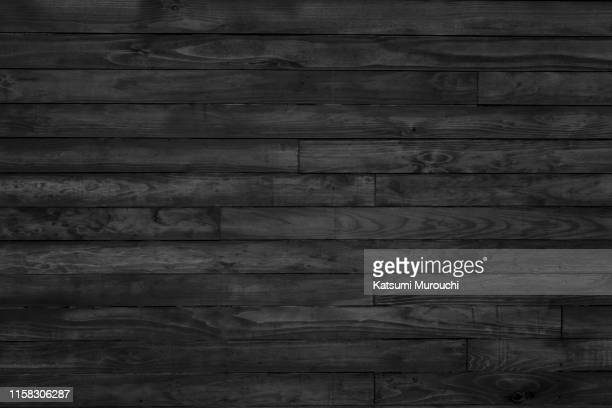 black wood paneling texture background - hardwood stock pictures, royalty-free photos & images