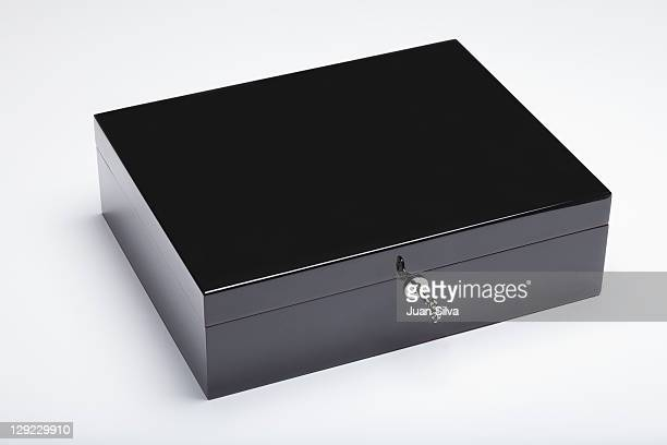Black wooden box with key