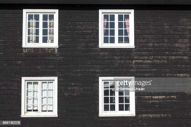 black wooden house - four objects stock pictures, royalty-free photos & images