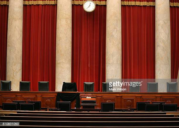 A black wool crepe covers the bench and seat where the late Justice Antonin Scalia would sit when court was in session at the US Supreme Court...
