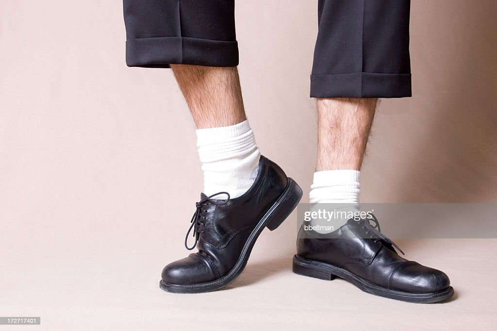Black work shoes with white socks and ankles : Stock Photo