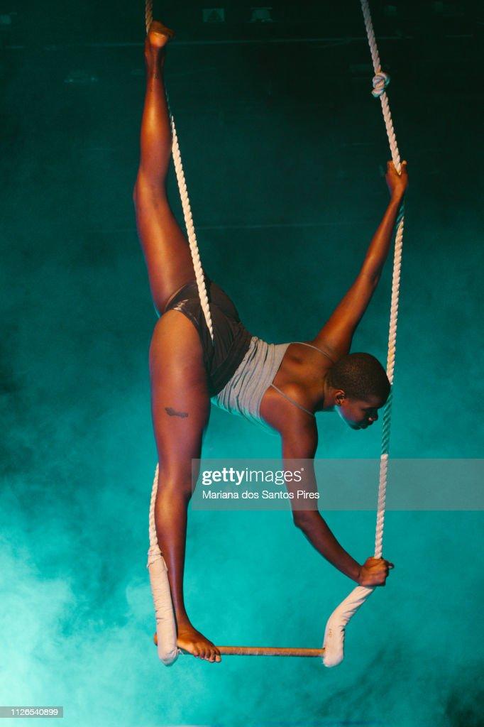 black young woman acrobat looking at camera