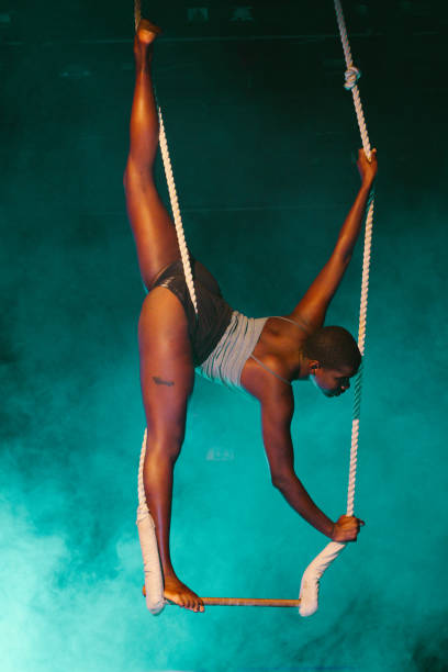black young woman acrobat looking at camera