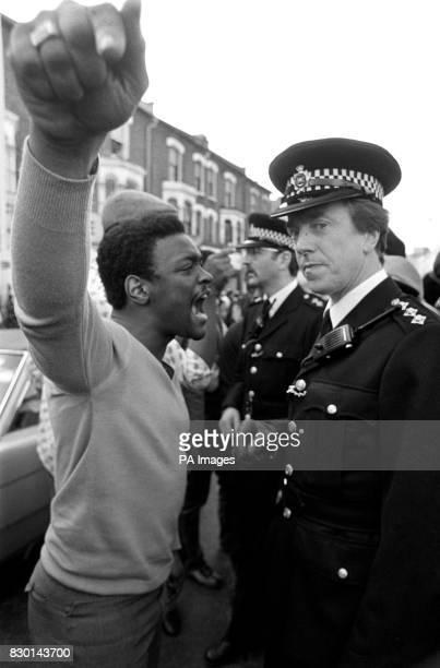 A black youth confronts a senior police officer during the disturbances in Brixton south east London