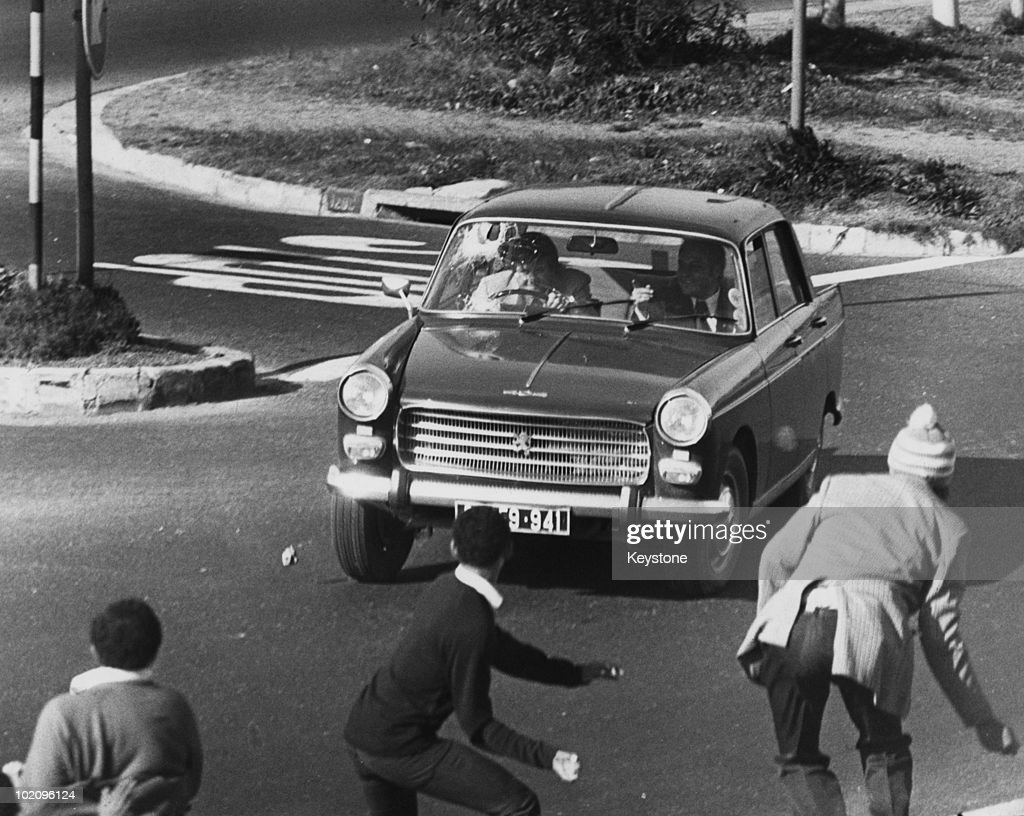 Black youths stoning a car during unrest in Athlone, Cape Town, South Africa, 16th September 1976. The violence comes in the wake of the Soweto uprising of the previous June.