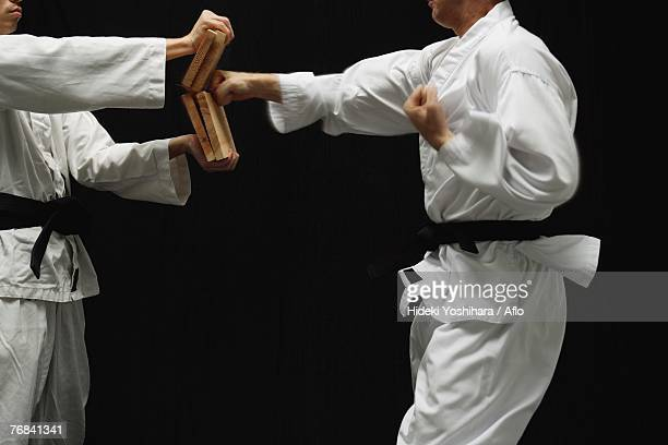 blackbelt breaking boards - martial arts stock pictures, royalty-free photos & images