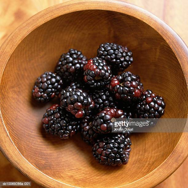blackberries in wooden bowl, directly above, studio shot