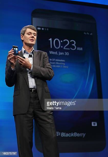 BlackBerry Chief Executive Officer Thorsten Heins speaks while holding one of the new Blackberry 10 smartphones at the BlackBerry 10 launch event by...