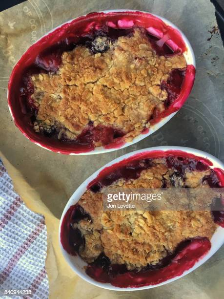 blackberry peach crisp two individual dishes