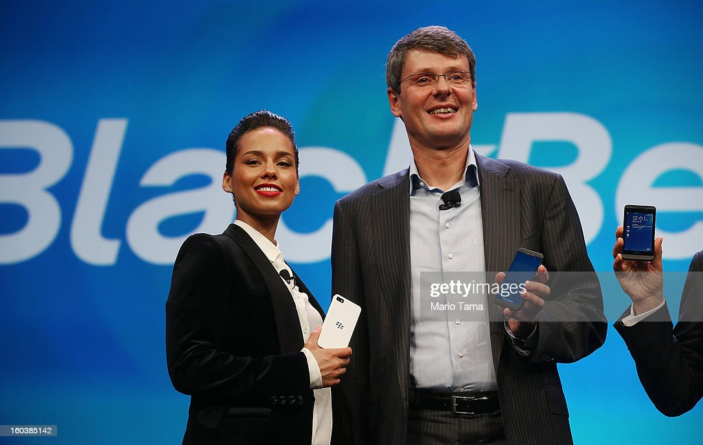 BlackBerry President and Chief Executive Officer Thorsten Heins (R) stands with new BlackBerry Global Creative Director Alicia Keys at the BlackBerry 10 launch event at Pier 36 in Manhattan on January 30, 2013 in New York City. The new smartphone and mobile operating system is being launched simultaneously in six cities.