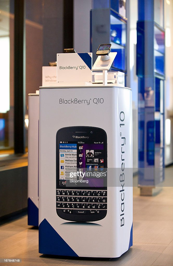 A BlackBerry Q10 display stands at a Bell Canada retail location in Toronto, Canada, U.S, on Tuesday, April 30, 2013. BlackBerry, the Canadian smartphone maker, climbed to its highest level in more than a month after Chief Executive Officer Thorsten Heins said he sees sales of its new Q10 device to be in the 'tens of millions.' Photographer: Galit Rodan/Bloomberg via Getty Images