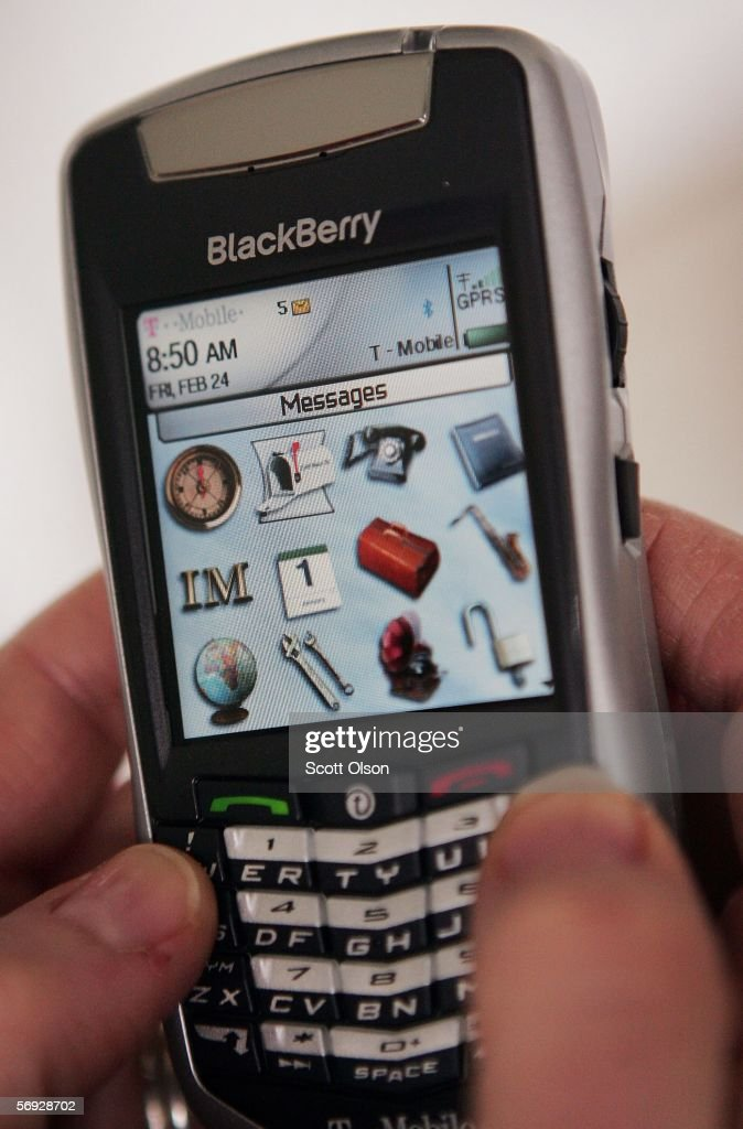 A BlackBerry user demonstrates one of the company's devices February 24, 2006 in Chicago, Illinois. Research in Motion, the makers of BlackBerry, will be in court today seeking to prevent an injunction stemming from a patent dispute from shutting down the service.