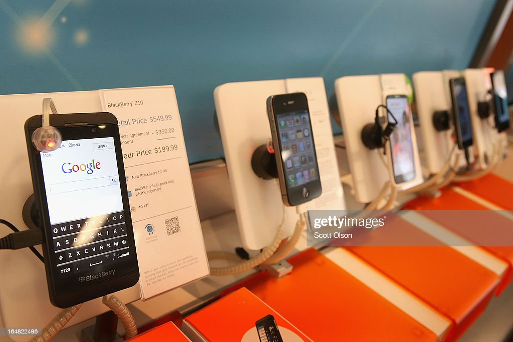A BlackBerry Z10 (L) is offered for sale alongside phones from other manufacturers at an AT&T store on March 28, 2013 in Chicago, Illinois. The Z10 has been selling above analysts' expectations, helping boost the company's stock price.