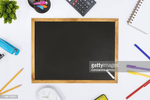 blackboard and school supply items on white desk - blackboard stock pictures, royalty-free photos & images