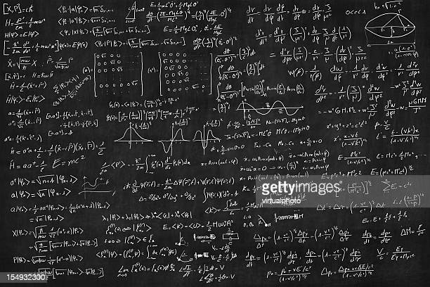 blackboard full of equations - physics stock pictures, royalty-free photos & images