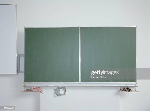 blackboard in a classroom - schreibtafel stock-fotos und bilder