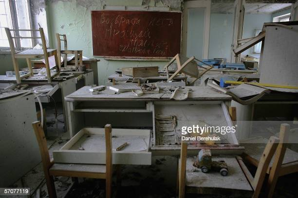 A blackboard is seen with chalk writing in an abandoned pre school in the deserted city of Pripyat on January 25 2006 in Chernobyl Ukraine The text...