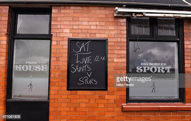 A blackboard on the side of a pub displays football game details during the Barclays Premier League match between Southampton and Tottenham Hotspur...