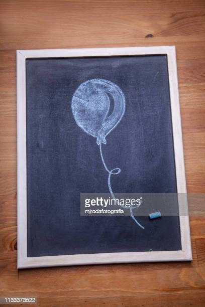 blackboard. there is a balloon drawn with blue chalk. - inspiración stock pictures, royalty-free photos & images