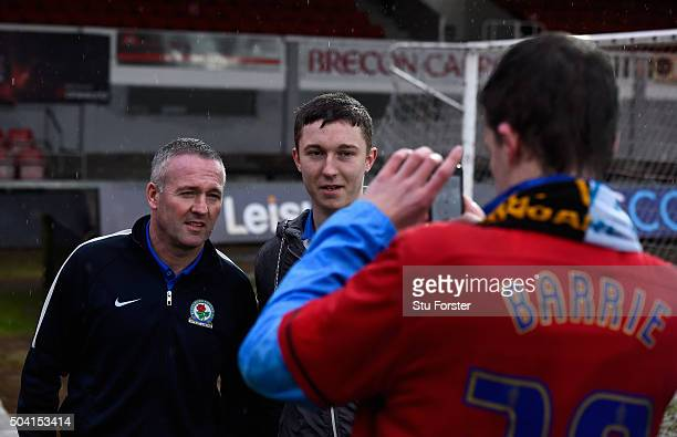 Blackburn manager Paul Lambert is pictured with fans after The Emirates FA Cup Third Round match between Newport County AFC and Blackburn Rovers at...