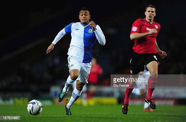 Blackburn player Josh King races away from Ben Turner during the npower Championship match between Blackburn Rovers and Cardiff City at Ewood park on...