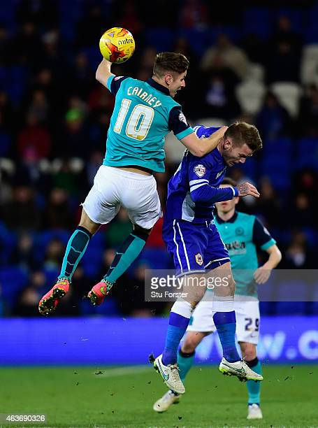 Blackburn player Tom Cairney challenges Aron Gunnarsson of Cardiff during the Sky Bet Championship match between Cardiff City and Blackburn Rovers at...